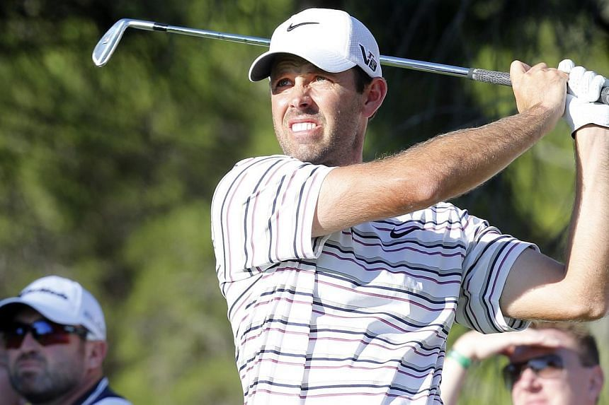 Charl Schwartzel of South Africa tees off on the 14th hole during the second round of the inaugural Turkish Airlines Open in the south west city of Antalya on Nov 8, 2013. Schwartzel shared the lead of the South African Open with Italian Marco C