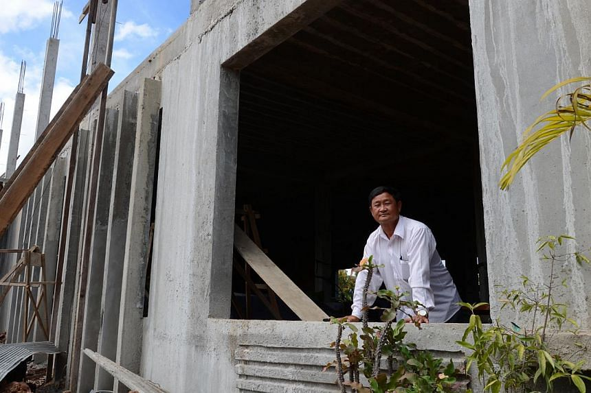 Mr Mock Sunheng, guesthouse owner in Tbaeng Meanchey, the provincial capital of Preah Vihear province. He is building a new 60-room hotel with swimming pool, gym, bathtubs and snooker table - relative luxuries in this part of Cambodia - to cater to t