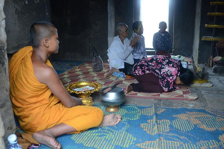 Local Cambodians pray at a shrine inside the Preah Vihear temple complex. -- ST PHOTO: TAN HUI YEE