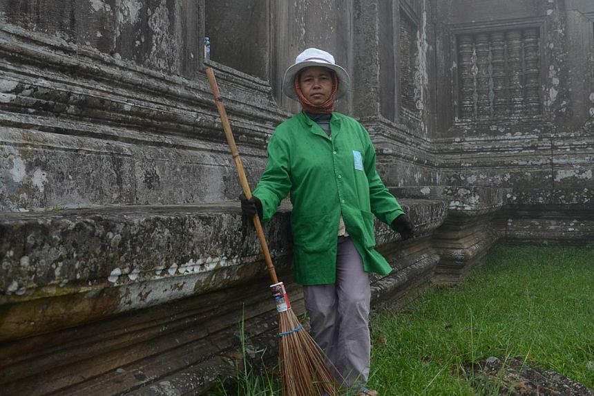 Ms Oum Thang, 50, a temple keeper at Preah Vihear temple in Cambodia, who had to crouch by a cliffside for safety during armed hostilities between Thailand and Cambodia in 2011. -- ST PHOTO: TAN HUI YEE