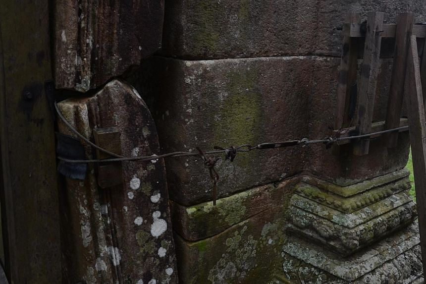 Wire holding together some parts of the walls at Preah Vihear temple. -- ST PHOTO: TAN HUI YEE
