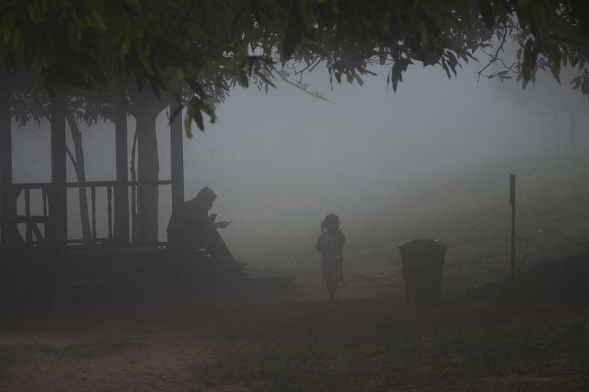 It's really cold as the morning cloud settles over the Preah Vihear temple compound. -- ST PHOTO: TAN HUI YEE