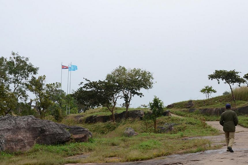 The Cambodian flag is flown high at the entry point to Preah Vihear temple. -- ST PHOTO: TAN HUI YEE