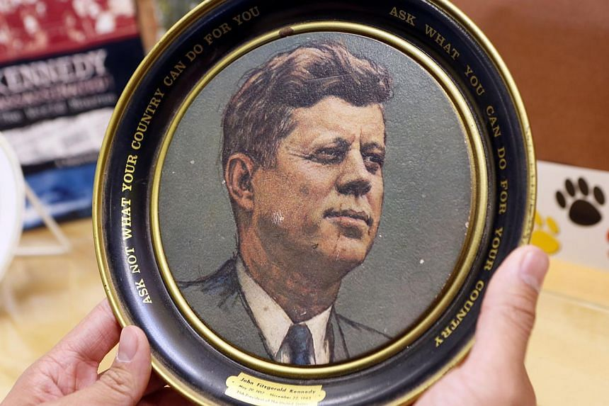 """A vintage plate with US President John F. Kennedy's inaugural address quote: """"Ask not what your country can do for you, ask what you can do for your country,"""" is displayed as part of the exhibit at the John F. Kennedy High School in Granada Hills, Ca"""