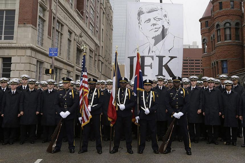 Members of the Dallas Police Department Honorary Color Guard pause for a photo after a ceremony to mark the 50th anniversary of the assassination of John F. Kennedy, Friday, Nov 22, 2013, at Dealey Plaza in Dallas. -- PHOTO: AP