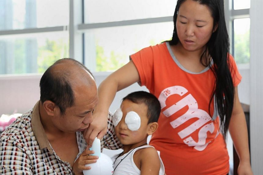 Guo Bin, the 6-year-old boy whose eyes were gouged out in August in Shanxi province, is recovering quite well, his eye surgeon said. -- FILE PHOTO: AFP PHOTO / C-MER DENNIS LAM EYE HOSPITAL