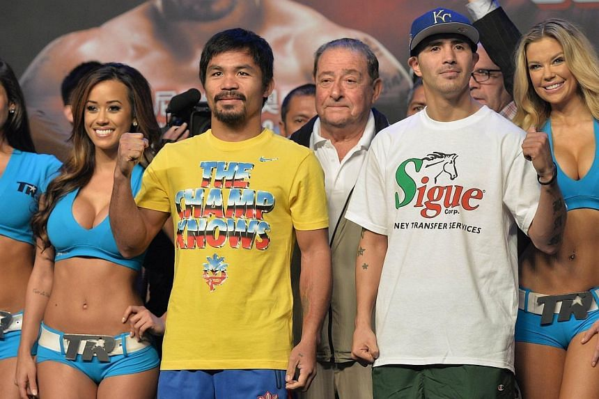 Philippine boxer Manny Pacquiao (third from left) and Brandon Rios (second from right) of the US pose after taking to the scale during the official weigh-in event in Macau on Saturday, Nov 23, 2013, one day ahead of their welterweight bout. -- PHOTO:
