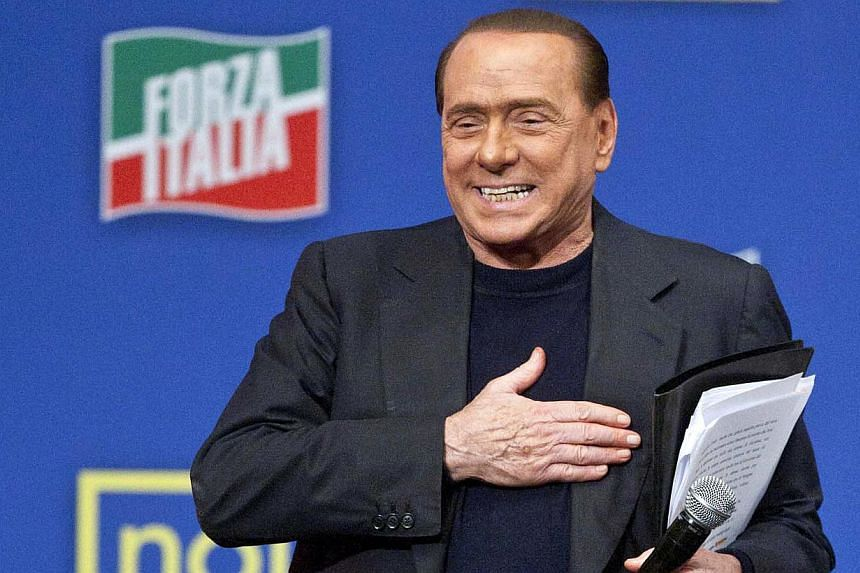 "Silvio Berlusconi addresses a rally in Rome on Nov 23, 2013. Former Berlusconi called on Saturday for a presidential pardon following his conviction for tax fraud and said his expulsion from parliament in a vote next week would be a ""coup d'etat"". --"