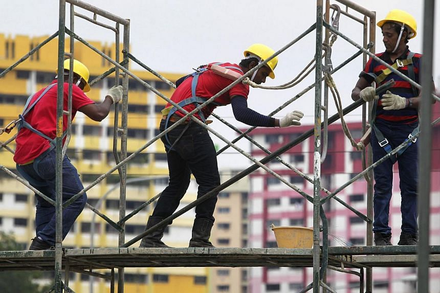 Foreign workers constructing a scaffolding at Kelantan Lane on Oct 16, 2012. Singapore has laws to protect foreign workers' rights but citizens also have a responsibility to be kind and humane towards them, said Professor Chan Heng Chee yesterday. --