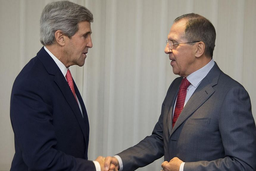 US Secretary of State John Kerry (left) and Russia's Foreign Minister Sergei Lavrov shake hands, during a photo opportunity, prior to their meeting, in Geneva, Switzerland, Saturday, Nov 23, 2013. Foreign ministers from world powers struggled on Satu