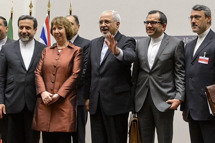 European Union foreign policy chief Catherine Ashton (third left) poses next to Iranian Foreign Minister Mohammad Javad Zarif and the Iranian delegation in Geneva on Nov 24, 2013. Iran and six world powers reached a breakthrough agreement early on Su
