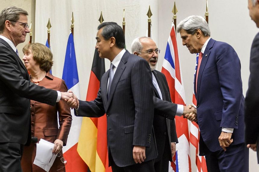 (From left) Foreign Minister Guido Westerwelle, European Union foreign policy chief Catherine Ashton, Chinese Foreign Minister Wang Yi, Iranian Foreign Minister Mohammad Javad Zarif, United States Secretary of State John Kerry and French Foreign Mini