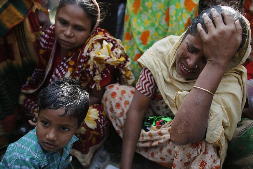 A relative of a garment worker, who is still missing after the Rana Plaza building collapse, cries during a protest in front of the site in Savar, on Sunday, Nov 24, 2013. Bangladesh police said on Sunday that they plan to charge the owner of a garme