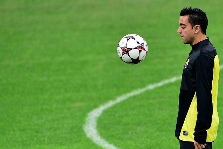 Injury-ravaged Barcelona will be bolstered by the return of Xavi Hernandez (above) for their Champions League visit to Ajax on Tuesday, but will be without full-back Adriano. -- FILE PHOTO: AFP
