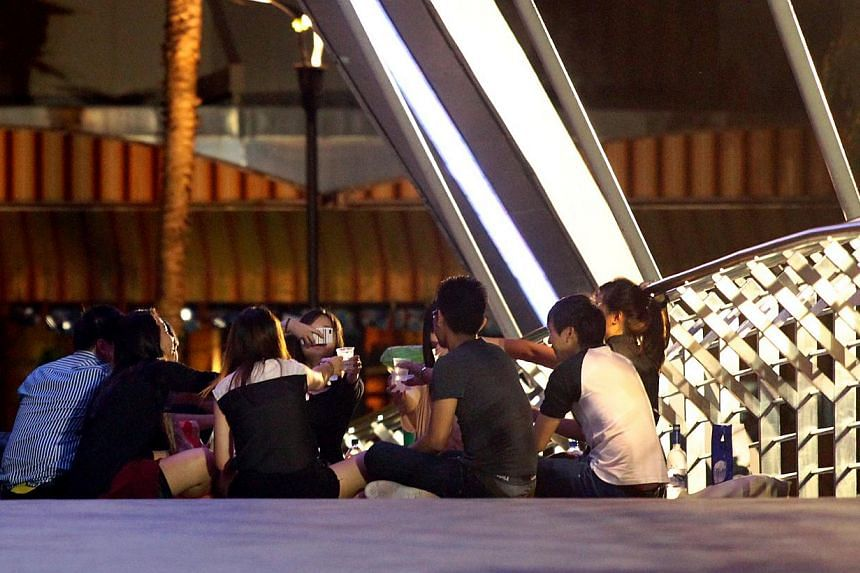 Groups of people drinking along the Singapore River at Robertson Quay. The Ministry of Home Affairs (MHA) and Government feedback arm Reach have launched a public consultation to seek views on proposed measures to designate no-alcohol zones at some p