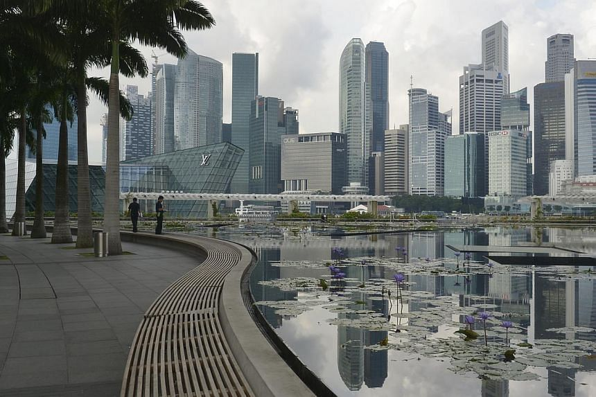 The Singapore skyline reflected in the lotus pond under the ArtScience Museum at Marina Bay Sands. Singapore's inflation came in at 2 per cent in October over the same month last year, up from 1.6 per cent in September. -- ST FILE PHOTO : ASHLEIGH SI