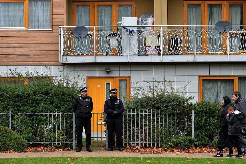 Police stand guard outside a block of residential flats in south London on Sunday, Nov 24, 2013, where investigations have centred following the arrest of a man and a woman suspected of holding three women captive in a London house for 30 years.&nbsp