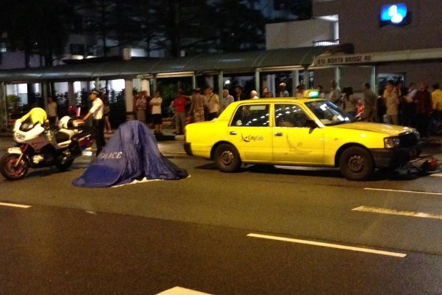 An elderly woman was hit and killed by a CityCab taxi while crossing the road on Monday night.-- ST PHOTO: LEE JIAN XUAN