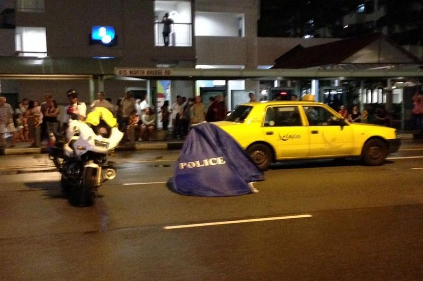 An elderly woman was hit and killed by a CityCab taxi while crossing the road on Monday night. -- ST PHOTO: LEE JIAN XUAN
