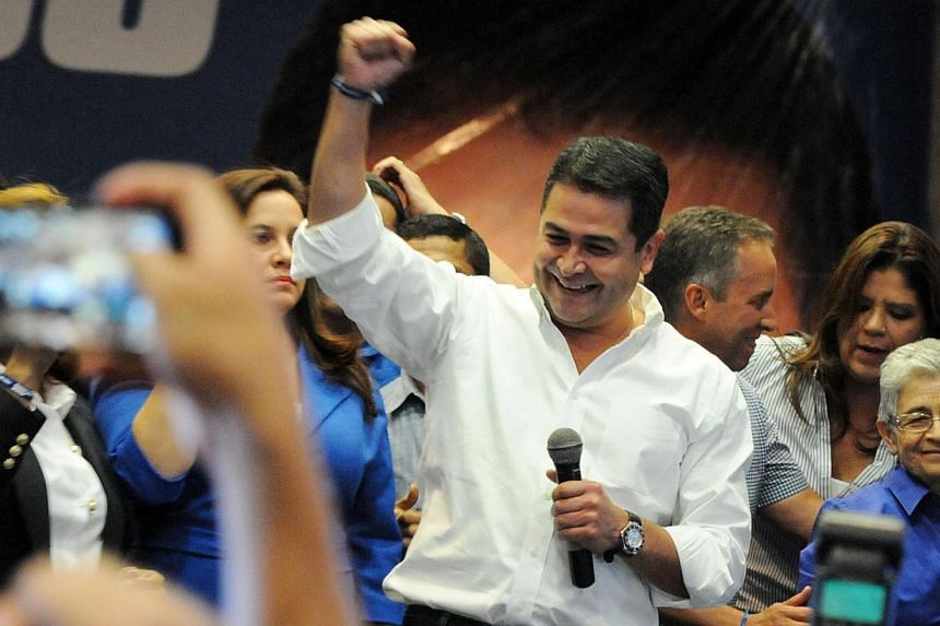 Honduras presidential candidate for the Partido Nacional (PN) Juan Orlando Hernandez speaks to supporters after claiming victory in the presidential vote, citing official electoral board results in Tegucigalpa on Nov 24, 2013.Conservative Juan