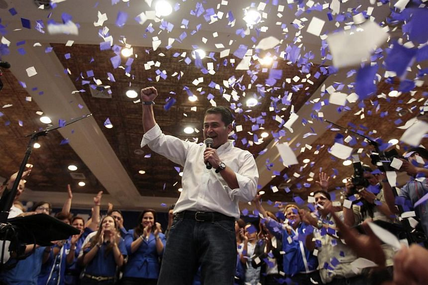 Juan Hernandez (centre), presidential candidate for the ruling National Party, addresses supporters in Tegucigalpa on Nov 24, 2013. -- PHOTO: REUTERS