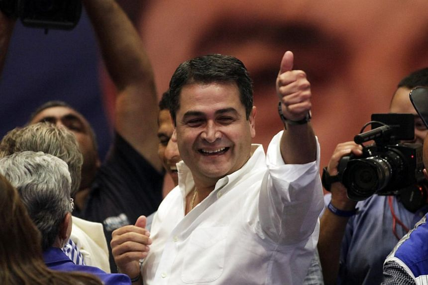Juan Hernandez, presidential candidate for the ruling National Party, gestures to supporters in Tegucigalpa on Nov 24, 2013. -- PHOTO: REUTERS
