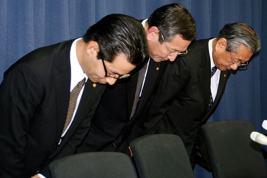 Japan's luxury Okura hotel chain executives bowing their heads at a press conference in Tokyo to apologise after the hotel served meals made with ingredients falsely labelled as being of top-end quality, such as Pacific white shrimp advertised as the