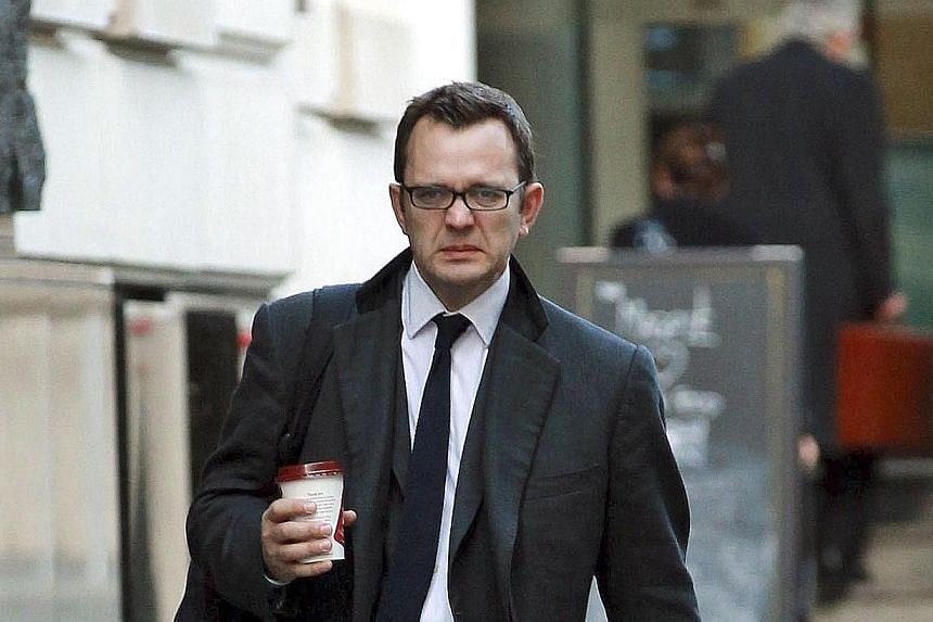 Former News of the World newspaper Editor Andy Coulson arrives at the Old Bailey court in London, as the trial on alleged phone hacking continues, on Thursday Nov 14, 2013. -- FILE PHOTO: AP