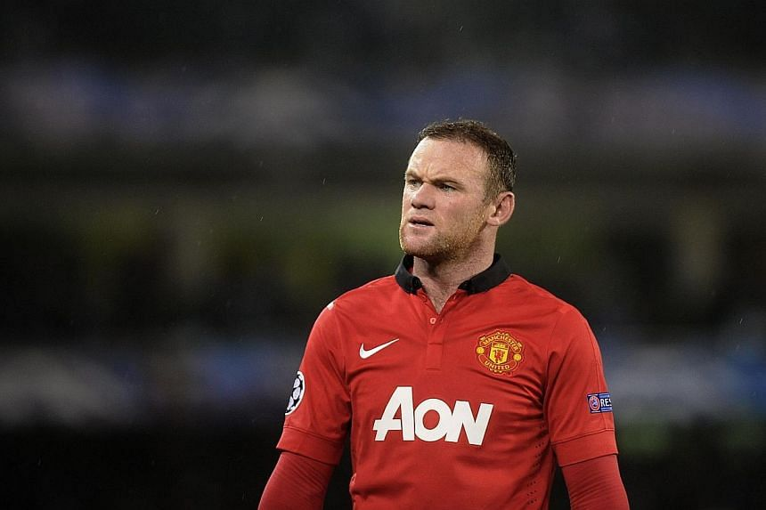 Manchester United's English striker Wayne Rooney gestures during the Uefa Champions League Group football match Real Sociedad vs Manchester United at the Anoeta stadium in San Sebastian, on Nov 5, 2013. Manchester United striker Wayne Rooney hit out