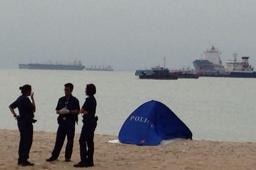 The body of a man, believed to be the Vietnamese who was reported missing after he had gone swimming off East Coast Park on Monday, was found on Tuesday morning. -- ST PHOTO: JAMIE KOH