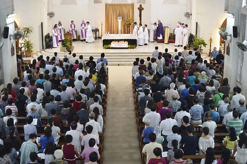 Archbishop William Goh holds his first mass for Typhoon Haiyan victims at the Church of Saints Peter and Paul on Tuesday, Nov 26, 2013. About 500 Singaporeans and Filipinos attended a solidarity mass led by Archbishop William Goh at the Chu