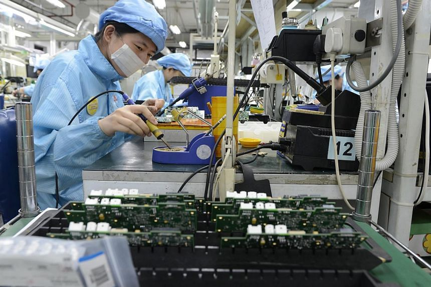 Singapore's factory output grew 8 per cent in October over the same month last year, boosted mainly by a surge in the electronics sector. -- ST FILE PHOTO:DESMOND FOO