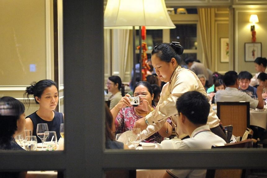 Overall customer satisfaction with the food and beverage, and tourism sectors has hit record highs this year with tourists being more satisfied with the service they received from both sectors, despite having higher expectations. -- ST FILE PHOTO:&nb
