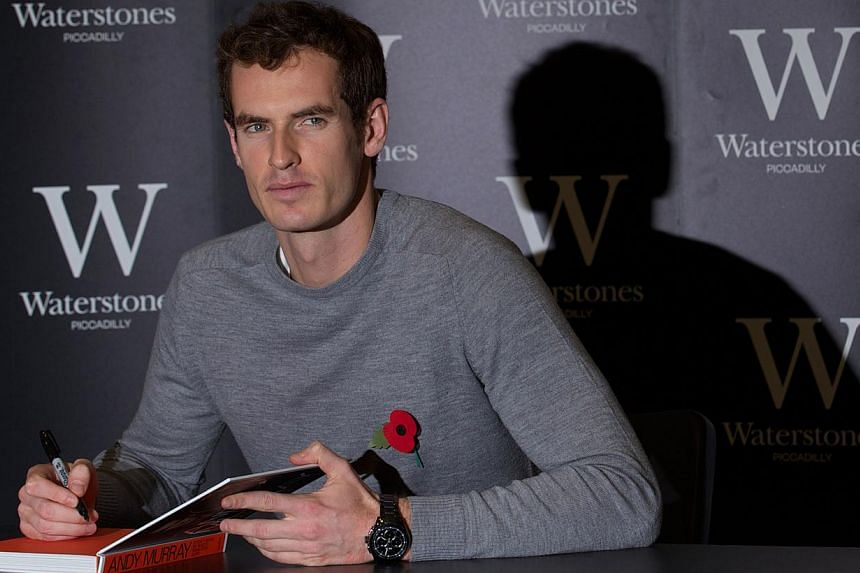 British tennis player Andy Murray poses for pictures as he launches his new book 'Seventy-Seven: My Road to Wimbledon Glory' at a bookstore in London, on November 6, 2013.Andy Murray was installed as the overwhelming odds-on favourite to