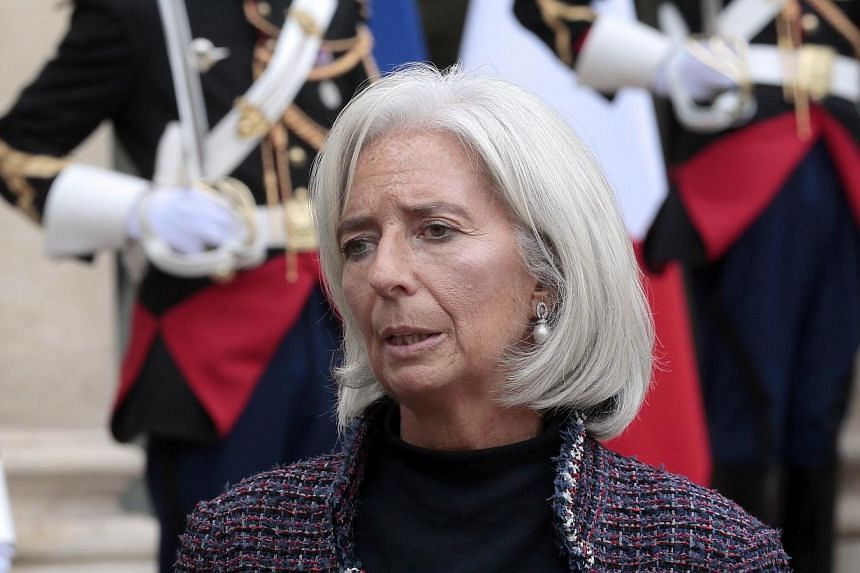 International Monetary Fund (IMF) managing director Christine Lagarde delivers a speech after a meeting at the Elysee presidential Palace in Paris on Nov 8, 2013. MrsLagarde will next month pay her first visit to Myanmar as the once authoritari