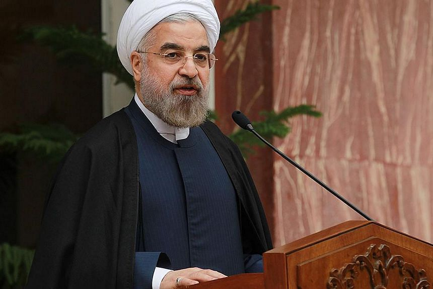 A handout picture released by the Iranian presidency shows the Islamic Republic's President Hassan Rouhani speaking during a press conference on Nov 24, 2013 in Tehran a day after a deal was reached on the country's nuclear programme. Iran's Pre