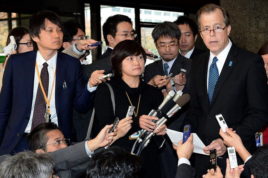 US Special Representative for North Korea Policy Glyn Davies (top, 2nd right) holds a question and answer session with journalists at the foreign ministry in Tokyo on Nov 25, 2013. In response to comments made by Mr Davies, North Korea on Wednesday s