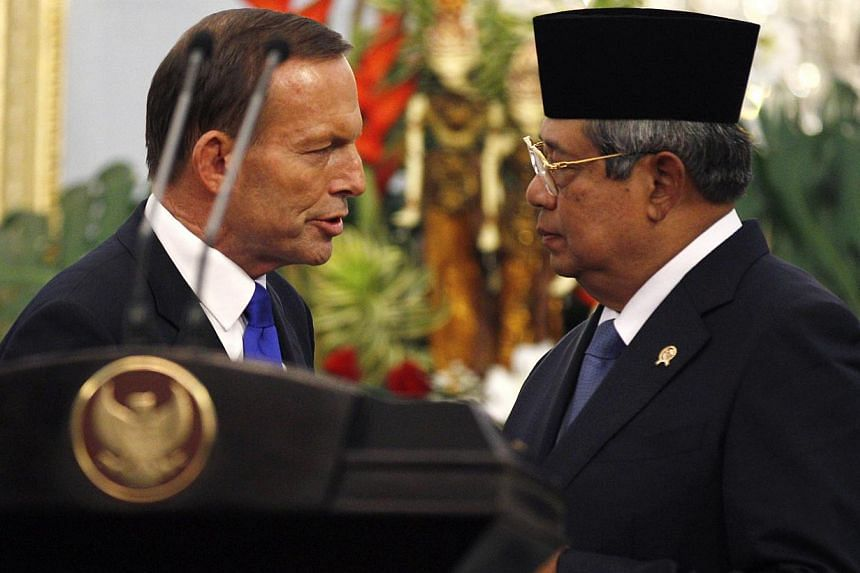 In this Monday, Sept 30, 2013 file photo, Australian Prime Minister Tony Abbott, left, speaks to Indonesia's President Susilo Bambang Yudhoyono after a joint press conference following their meeting at Merdeka Palace in Jakarta.Mr Abbott on Wed