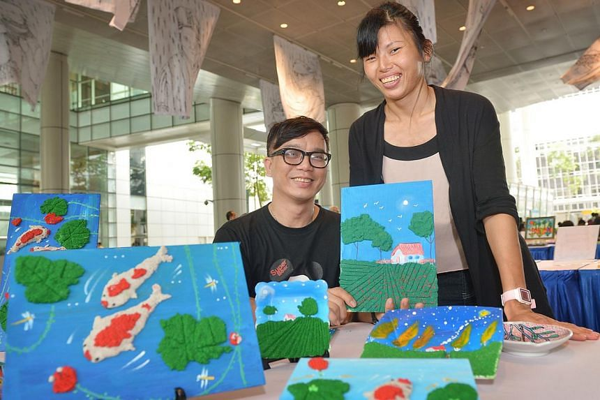 Mr Patrick Yee, 49, is a part-time art instructor with the Cerebral Palsy Alliance Singapore. He works with clients such as Ms Xiu Zhan, 29, to express their thoughts through non-verbal means with various materials. The organisation held an art exhib
