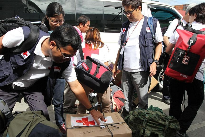 Members of the Singapore Red Cross medical response team arriving in Ormoc, Leyte province of the Philippines, with about $5,000 worth of supplies, including basic medicine for cough, infections and allergies. SRC has raised $3.8 million for victims