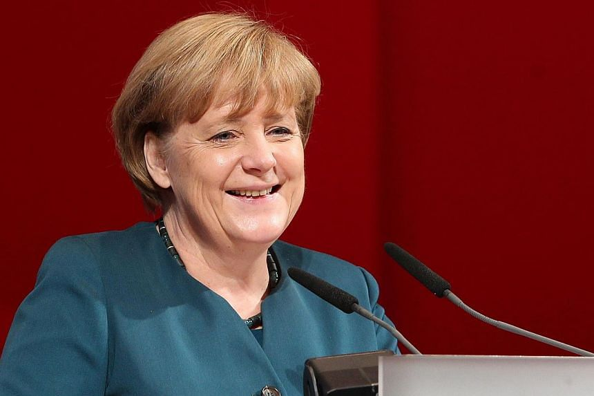 German Chancellor Angela Merkel (above) agreed to form a coalition government with campaign rivals the Social Democrats on Wednesday, Nov 27, 2013, two months after her conservatives won elections but fell short of a full majority. -- PHOTO: AFP