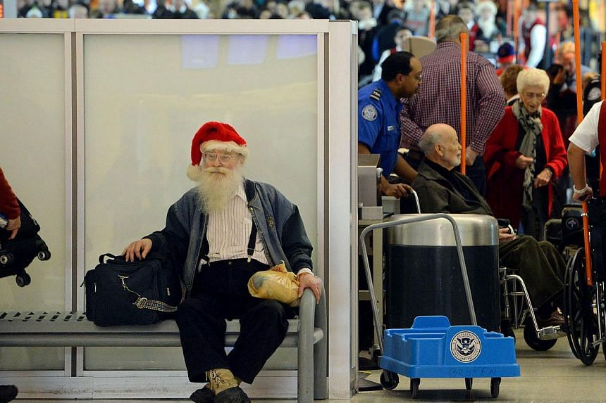 William Witters, of Valparaiso, Indiana, waits for a ride in a wheelchair after passing through security at Chicago Midway International Airport on Tuesday, Nov 26, 2013.Thanksgiving travellers scrambled to book earlier flights on Tuesday to av