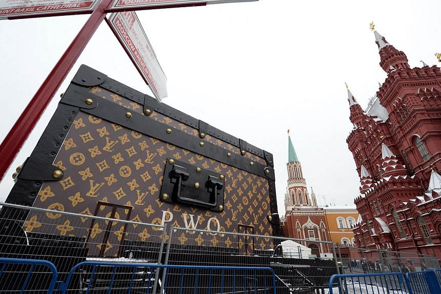 A giant Louis Vuitton trunk rises on Red Square in Moscow on Wednesday, Nov 27, 2013. -- PHOTO: AFP