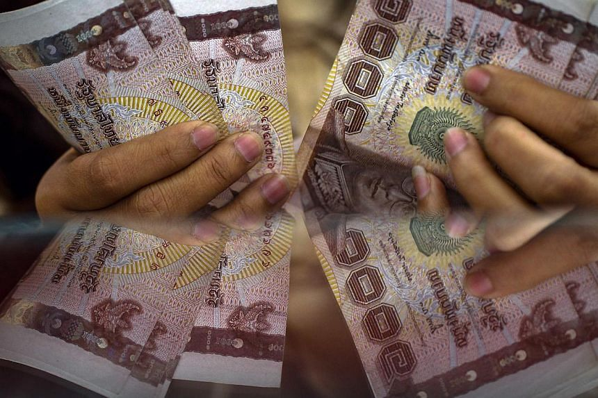 Thepolitical protests in Bangkok have sent the Thai baht tumbling to a 12-year low against the Singapore dollar. While tourists to the country might be smiling, Singapore firms with operations in Bangkok are starting to feel the heat. -- FILE P