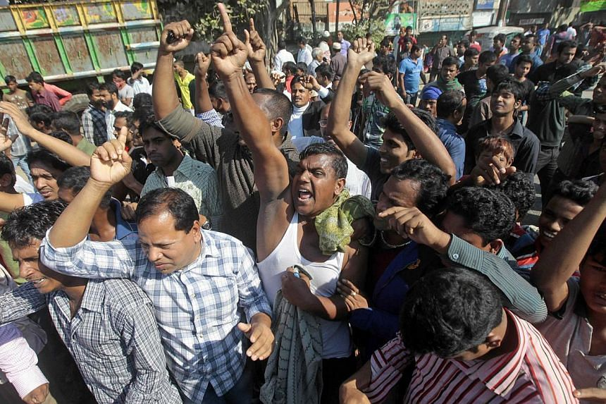 Bangladesh's main opposition Bangladesh Nationalist Party (BNP) supporters shout slogans during a 48-hours nationwide strike in Dhaka, Bangladesh, on Tuesday, Nov 26, 2013. Bangladesh's general election in early January could be postponed to accomm