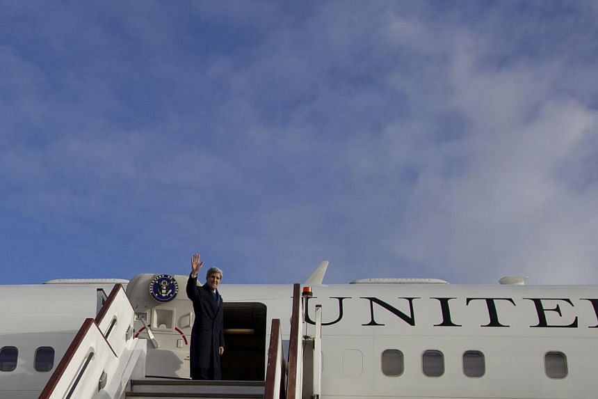 US Secretary of State John Kerry turns and waves as he boards his aircraft at London's Stansted Airport, on Nov 25, 2013, en route to Washington.The US administration stepped up its battle on Tuesday to thwart moves by lawmakers tighten sanctio