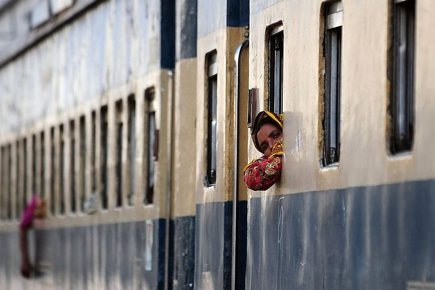 Bangladeshi commuter looks out from a train coach as she waits to depart on the the railway terminal during a blockade organised by Bangladesh Nationalist Party (BNP) activists and its Islamist allies in Dhaka, on Nov 27, 2013. Bangladesh opposi