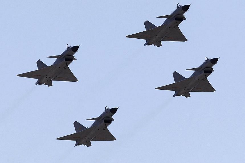 Jian-10 fighter jets of China's air force fly at Yangcun Air Force base on the outskirts of Tianjin municipality in this April 13, 2010, file photo.China's military could struggle to cope with the demands for intensified surveillance and interc