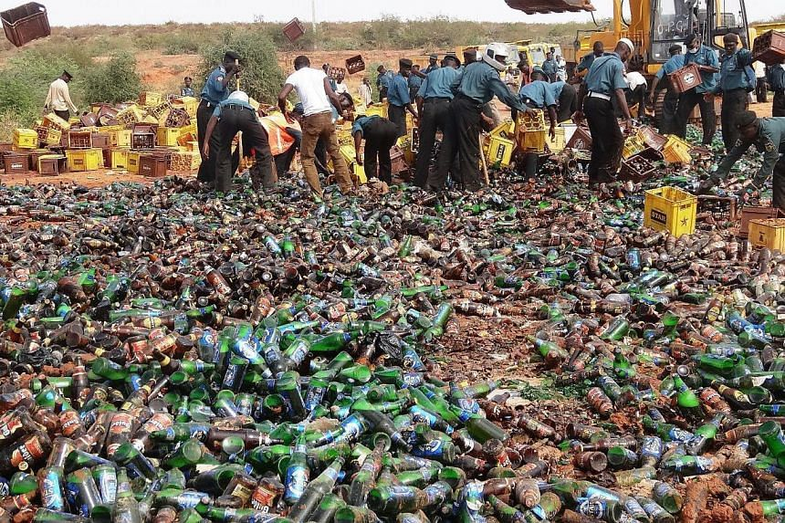 Sharia enforcers called Hisbah destroy thousands of bottles of beer outside northern Nigeria's largest city of Kano on Nov 27, 2013. Police enforcing Islamic law in Nigeria's city of Kano publicly destroyed some 240,000 bottles of beer on Wednes
