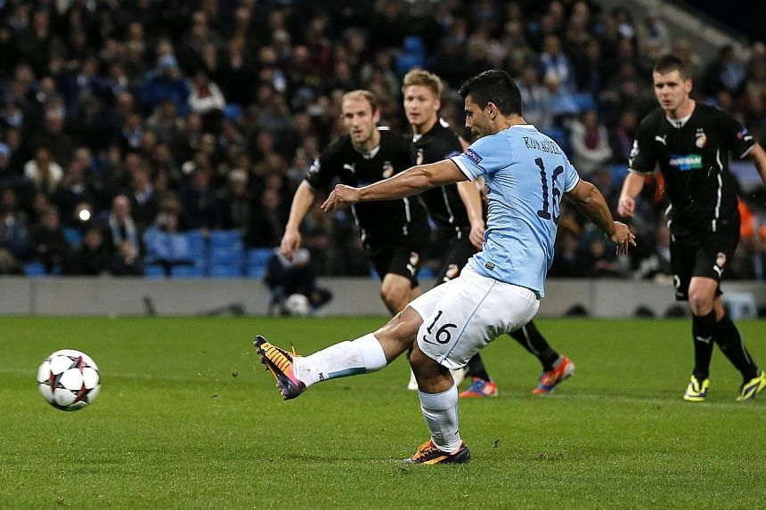 Manchester City's Sergio Aguero scores from the penalty spot during their Champions League soccer match against Viktoria Plzen at the Etihad Stadium in Manchester, northern England on Nov 27, 2013.  The hosts took the lead on 33 minutes whe
